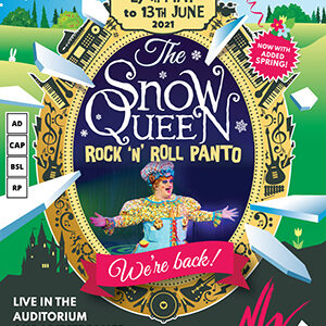 The image shows the artwork for 'The Snow Queen,' but this time with a more spring and summery theme - the background, while still under faint snow and shattering shards of ice, is a lush green with flowers and a light blue sky and large yellow sun. The mirror now reads the dates '27th May to 13th June 2021' and shows a photograph of Dame Sigrid Smorgasbord with her arms outstretched towards the audience at the bottom. The pink banner in front of the mirror reads 'We're back' and a matching pink circle in the top right reads 'Now with added spring!' Four boxes on the left show the show has audio description, captioning, British Sign Language and relaxed versions available and in the bottom left of the image is the information that the show is live in the auditorium and on livestream. To book, simply call 01473 295900 or browse our website at wolseytheatre.co.uk.
